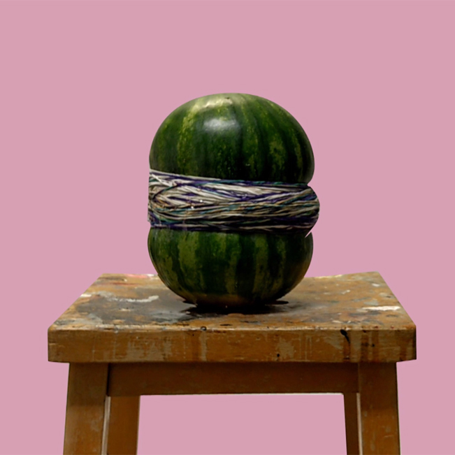 Elastic bands around a watermelon