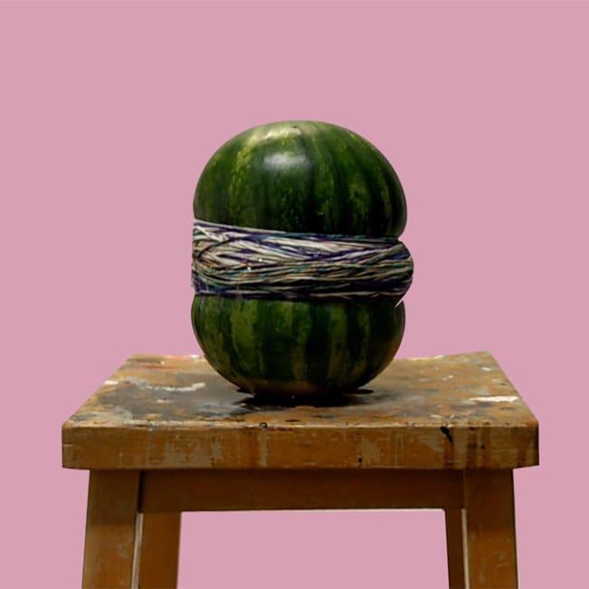 Elastic bands around a watermelon