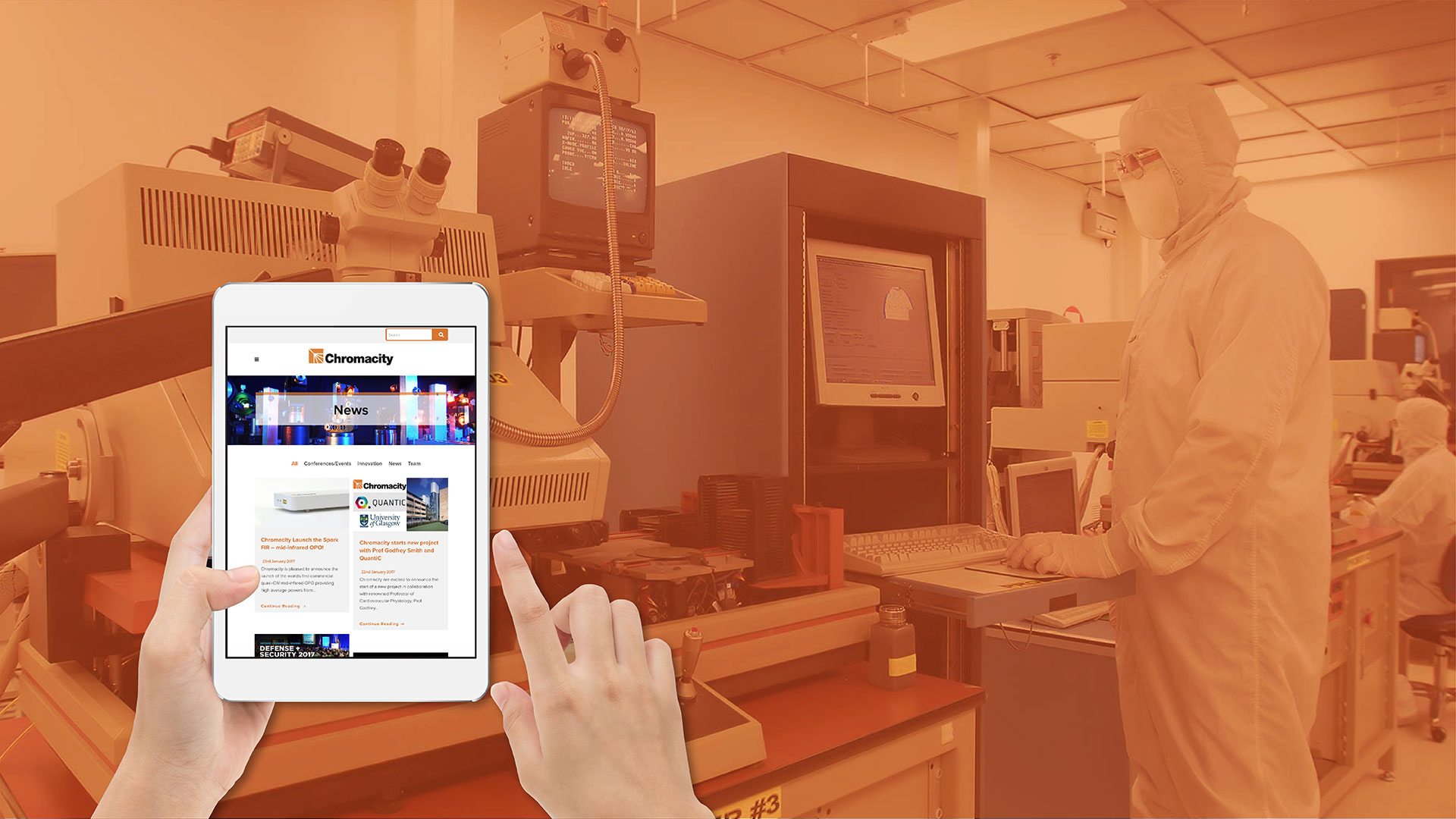 iPad displaying Chromacity website against backdrop of laser laboratory