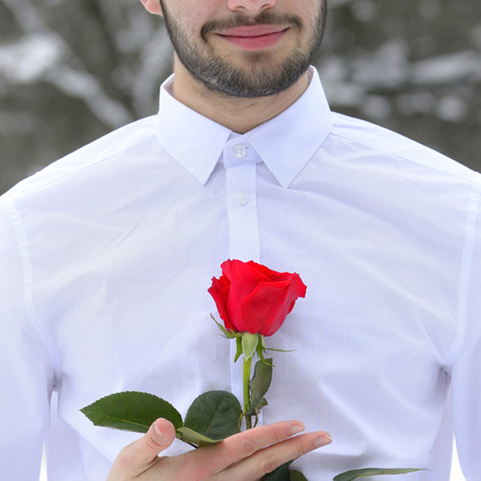 Guy in a shirt holding a rose