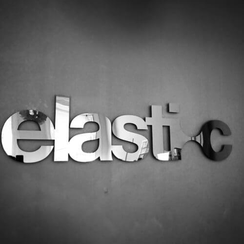 Elastic logo on a black wall