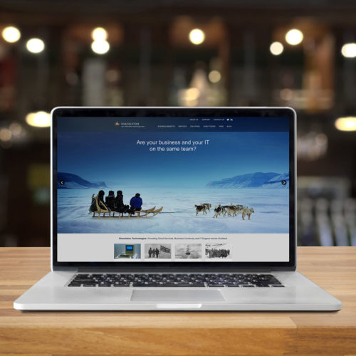 Shackleton Technologies website displayed on a laptop